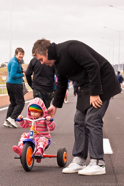 Father teaching child to drive on new motoway - Hobsonville, Auckland, New Zealand