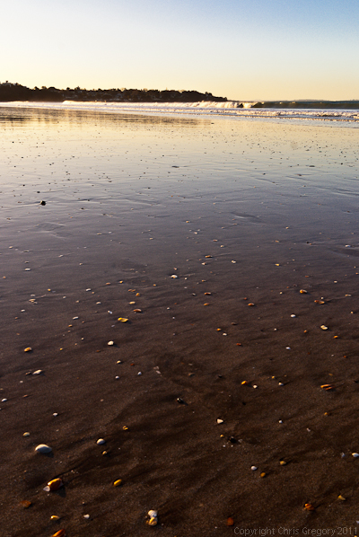 Surface water reflecting surf and sky, Takapuna Beach, Auckland, New Zealand