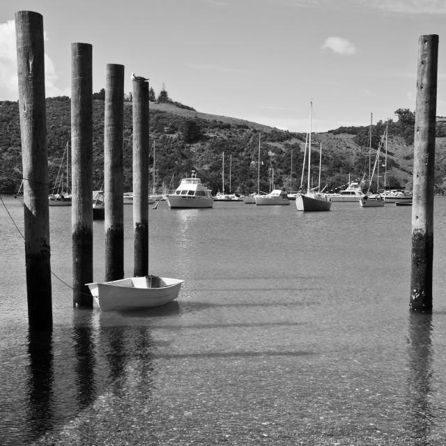 Between the Piles, Dinghy and Yachts in Matiatia Bay, Waiheke Island, New Zealand, Copyright Chris Gregory 2011